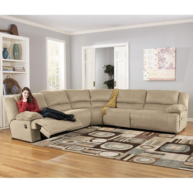hogan  khaki sectional living room set signature design