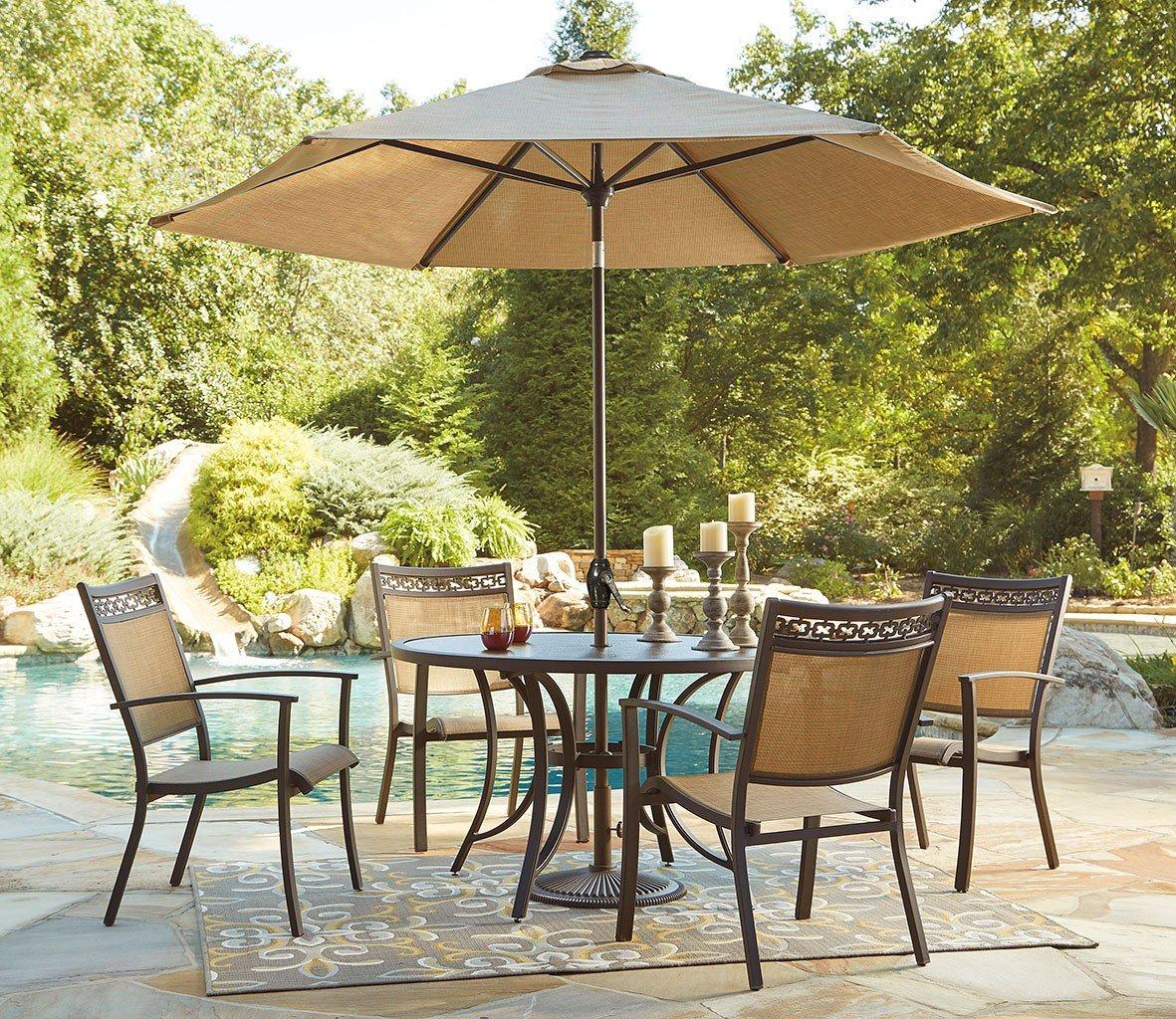 Carmadelia Round Outdoor Dining Set W Umbrella Signature Design Furniture Cart